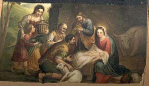 Jesús en su pesebre con sus padres