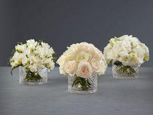 imágenes de tres arreglos florales para boda